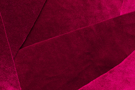 Beautiful luxury dark purple patchwork velvet texture background cloth. flaps of velvet fabric with a reflection Stock Photo