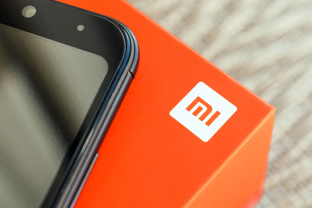 KIEV, UKRAINE - MAY 28, 2018: Xiaomi Redmi 5 Plus black new smartphone with orange box close up developed by Xiaomi Inc. Xiaomi is privately owned Chinese electronic company. Stockfoto - 109529298