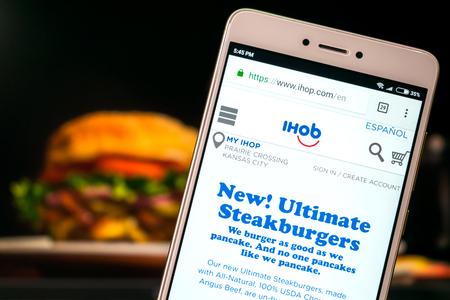 KROPIVNITSKIY, UKRAINE – 8 JULY, 2018: IHOP  website on mobile screen on blurred burger background. IHOP rebrand, IHOP  Changing Name to IHOb Editorial