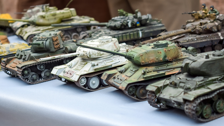 Model toy miniature Soviet Tanks. Various camouflage Military Tank panzer models on table
