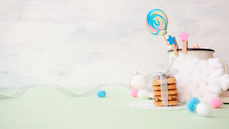 Cookies stack gift with festive Christmas winter decor on a bright punchy colors pastel blue background 스톡 콘텐츠