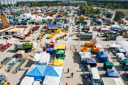 KROPIVNITSKIY; UKRAINE  – 22 September; 2017: Panoramic aerial view agricultural exhibition Agroexpo-2017. Exhibitors, Visitors, Agricultural machinery in agricultural fair