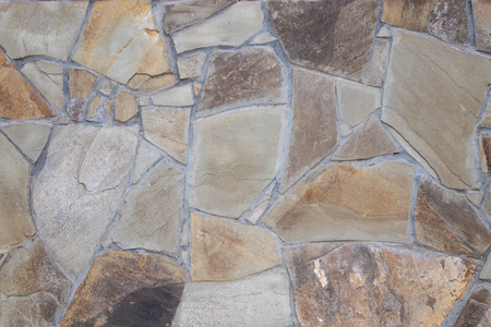 Fragment of wall from chipped stone. facing stone wall texture.