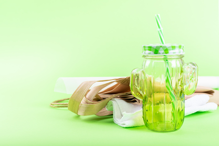 Zero waste living concept. Zero waste no plastic kit, Reusable Bag, Mason Jar, Microfiber Cloth, craft paper bag on green background