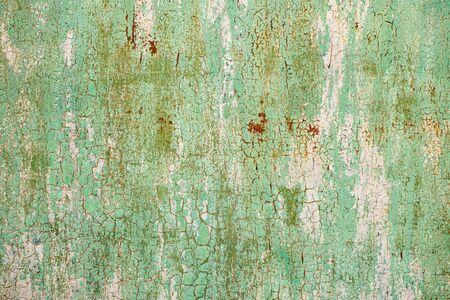 Métal orange vert et rouge Résumé vieux fond texturé. Craquelure. Texture craquelée rugueuse.