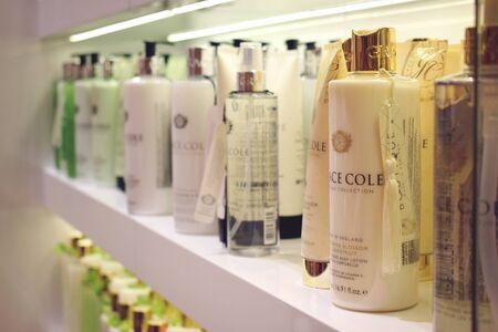 Kiev, Ukraine – 19 September, 2018: Woman chooses cosmetics Body care product for the shower, bath, body lotion, Body spray Grace Cole in beige bottle in beauty shop, store, spa salon.
