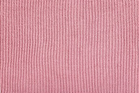 Pink Knitted Fabric background. Knitted woolen fabric rose Texture. Abstract wool sweater texture close up.