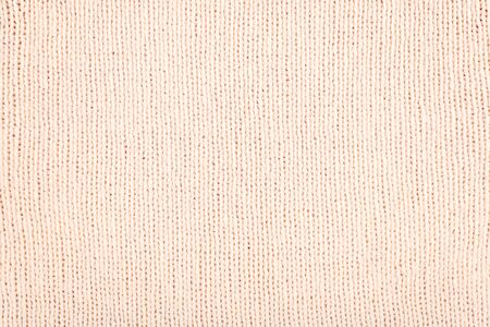 Pink light Knitted Fabric background. Knitted woolen fabric rose Texture. Abstract wool sweater texture close up.