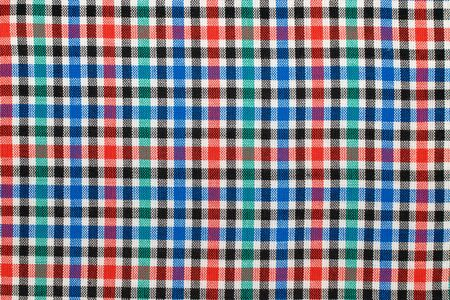 Checkered plaid fabric background. Texture of red blue green plaid fabric cloth.  Stock Photo