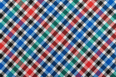 Diagonal Checkered plaid fabric background. Texture of red blue green plaid fabric. 写真素材