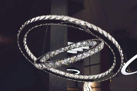Crystal rings LED chandelier pendant light. Modern chandelier in the form of rings decorated with glass crystals diamonds.