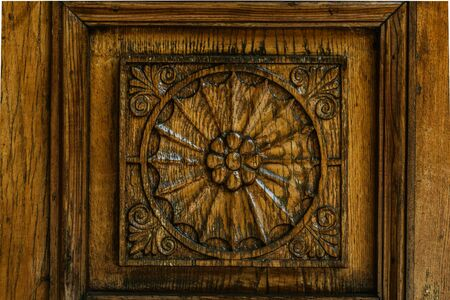 .Carved wood pattern, retro element of decor. Exquisite wood carving technology.