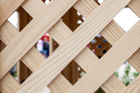 Old wooden lattice background. Partition wooden texture. Wooden arbor pavilion with lattice. Reklamní fotografie