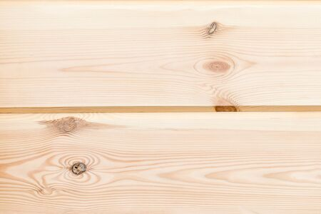Wood Glued timber plank close up background. Wooden construction glued laminated timber in the wall of the house. Glued beams texture. Natural pattern pine wood background.