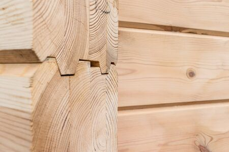 Wood Glued timber close up background. Wooden construction glued laminated timber in the wall of the house. Glued beams. Wooden beams in the groove. Reklamní fotografie