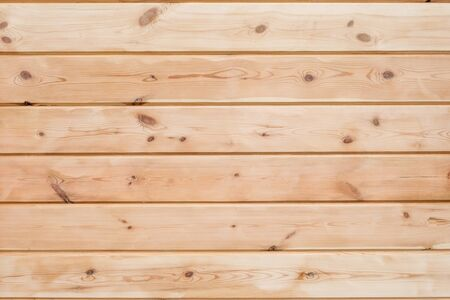 Wood Glued timber plank background. Wooden construction glued laminated timber in the wall of the house. Glued beams texture. Natural pattern pine wood background.