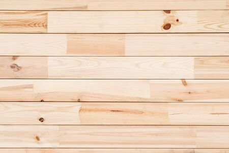 Wood Glued timber plank close up background. Wooden construction glued laminated timber in the wall of the house. pine wood plank texture and background. Natural pattern pine wood background.