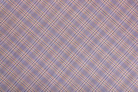 Diagonal Checkered fabric. brown beige blue checkered fabric closeup , tablecloth texture. Stockfoto