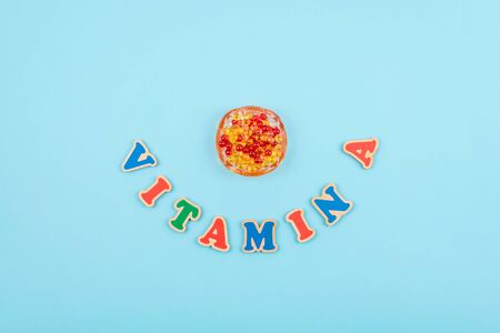 Vitamin A word colored wooden letters on blue background. 写真素材