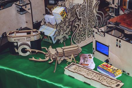 KROPIVNITSKIY, UKRAINE, 12 MAY, 2018: Plywood 3D printer graber i3. Wooden Three dimensional printing machine and various 3D printing detail.