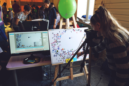Kropivnitskiy, Ukraine – 12 May, 2018: Girl making Stop motion animation process with magnetic letters, paper alphabet on board and computer monitor with the program for creating animations. 報道画像