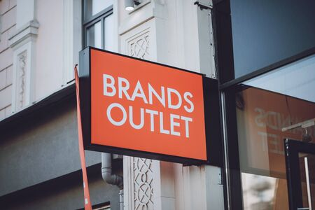 Brands outlet sign on city street. Signboard of modern cloth store, shop, mall, boutique. Display in mall. Kiev, Ukraine - September 02, 2019. 写真素材