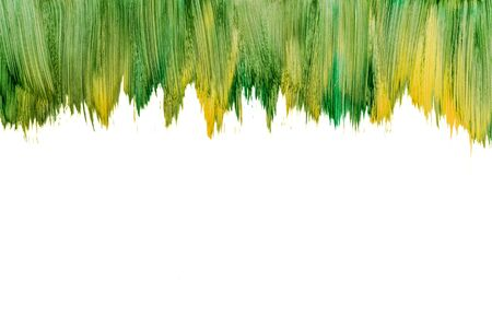 Action painting watercolor green brush mockup isolated on white. Abstract Hand-painted yellow and green natural art background. Multicolored paint strokes. Copy space.
