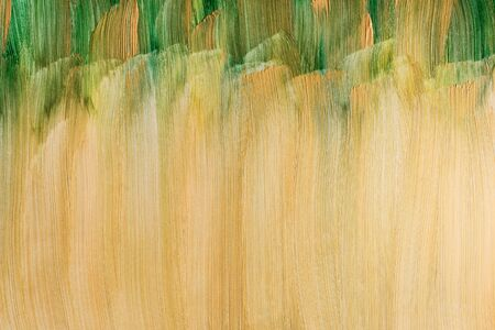 Action painting. Abstract Hand-painted golden yellow and green art background. Multicolored paint gold strokes.