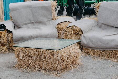 Upcycling ideas, Recycle crafts for home. coffee table and chair made of straw bales. Alternative eco-friendly furniture.