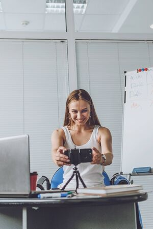 Smart working, agile, remotely working, Flexible hours, rearranged offices, new way of organising work. Young woman, company employee communicates with colleagues remotely.