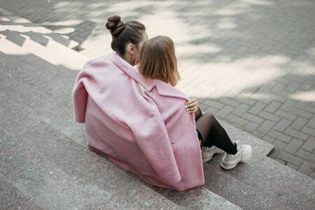 Pride Month, LGBT History Month, LGBT Lesbian couple love moments concept. Two Young lesbians girls hugging outdoors