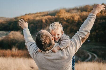 Fathers day, Happy loving family. Father and son playing, having fun on the nature. Happy family, Fathers Day and local summer vacation Zdjęcie Seryjne