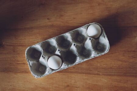 Social distancing, stay safe, post covid, new normal concept with only two egg in packaging paper mould box. Stock Photo