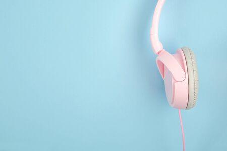 ASMR, Autonomous sensory meridian response, sensory meridian response concept with pink headphones on blur background. 写真素材