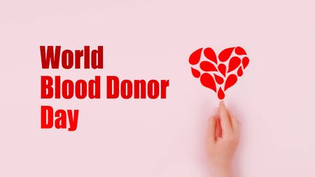 World Blood Donor Day background with copy space. Blood donor day campaign for donation charity concept with red drops heart and hands. Giving blood saves lives.