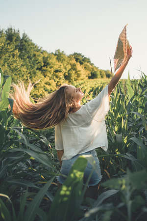 Relaxation, meditation mental health concept. Work life balance. National Relaxation Day. Young blonde woman meditates and relaxes in nature outdoor field at sunset.