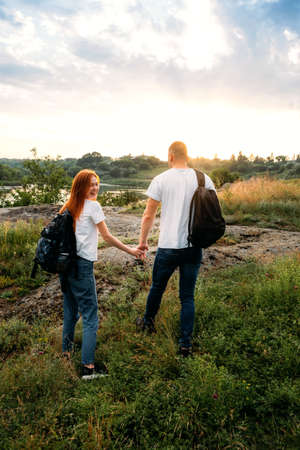Local travel, Solo Explorers, Small Group tourist. Young couple going for hiking, walk in nature. Summer Outdoor Activities. Caucasian hiker couple enjoying themselves on summer vacation