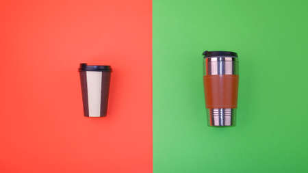 Refillable and disposable coffee cups on half red and green background. Plastic-free and zero waste living concept.