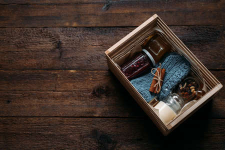 Care box, package ideas. Fall or Winter care box with sweets and warm clothes. Care Package Delivery, Fall Winter holidays Food Care gift box