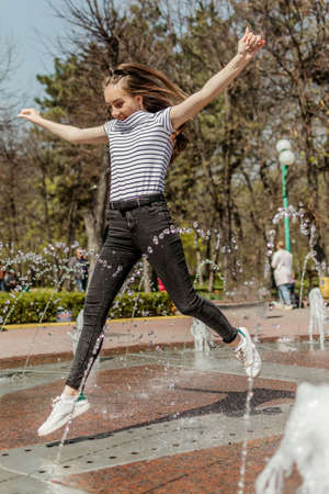 Youth culture, freedom youth teenager, gen z, millennial generation lifestyle. Happy teen girl having fun at park in sunny day.