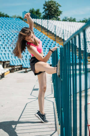 Fitness for Female Beginners, woman fitness, physical activity for teenagers. Young sporty girl having workout, running, doing exercises on the stadium