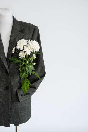 Sustainable fashion, organic clothes, eco clothing, ecology, sustainability, responsible fashion, 100 cotton. Formal Bio fabric suit with chrysanthemum flower on light background.