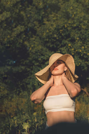 Embracing Natural Beauty, Pamper yourself, Skin care tips. Young woman with natural beauty enjoying nature on sunny summer day Stok Fotoğraf