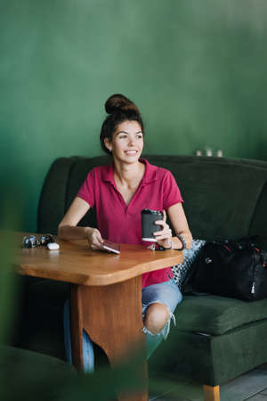 Mental health services, Online therapist-led emotional fitness classes and one-on-one therapy. Young Latina woman using Mental Health Apps on cell phone. Alternative to Therapy