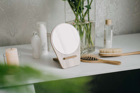 Self care, Healthy Mind, Body and Soul. Ways to Take Care of Yourself. Self-care practices and routines. Beauty tools, mirror and glass of water on table at bedroom.