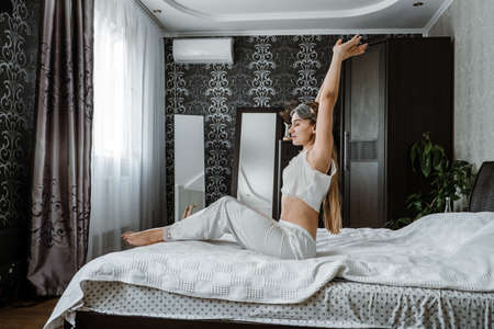Self care, Mental health, mental wellbeing, calm, mourning routines, start day. No stress, healthy habit, concept. Young woman in pajamas doing morning routines.