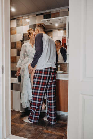 Love, Honeymoon, Romantic, togetherness, tenderness, relationship. Young couple bonding trough morning routine. Happy couple in love brushing teeth in bathroom at home.