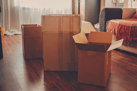 Moving day, Move Into New Home, Moving home checklist. Carton boxes with clothes and other things prepared for moving in or moving out of home.