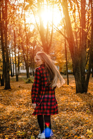 Vitamin D in autumn and winter season. Vitamin D in Womens Health, Role of Vitamin D3 Supplements in female health. Young woman enjoying sun in fall nature background Stock Photo