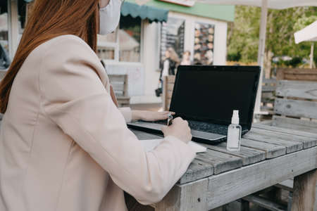 Data privacy, data wellbeing, management, personal information, digital identity, digital behavior, security issue, data hygiene, cybersecurity. Redhead woman entering data on laptop